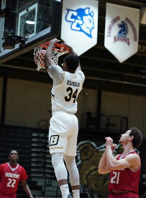 Bryant's Hall Elisias throws down a dunk in Saturday's 85-55 semifinal win over Sacred Heart. Elisias had 18 points, nine rebounds and three blocks.