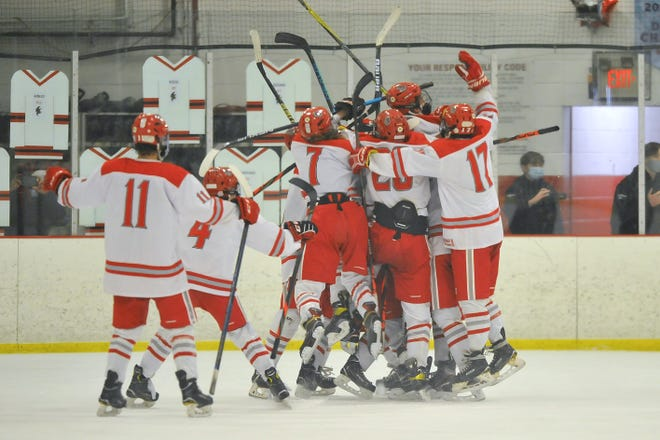 Members of the Cranston co-op team celebrate after Kaden Santurri scored in overtime on Friday in the opener of the best-of-three Division II championship series. Cranston completed the sweep on Saturday night.