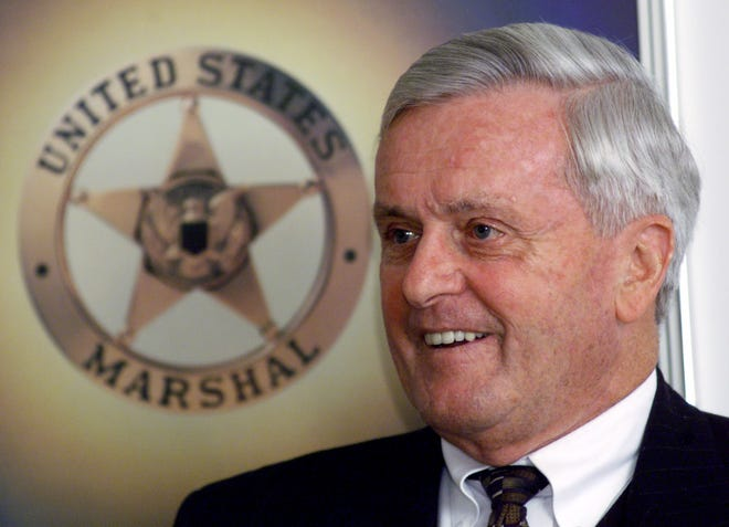 John Leyden, U.S. marshal for the State of Rhode Island, smiles during his retirement announcement in Providence in December 2001. Leyden died Wednesday at age 89.