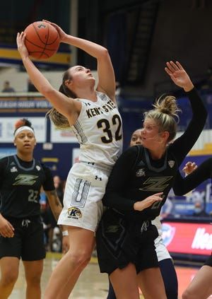 Kent State junior guard Hannah Young grabs a rebound over Akron sophomore guard Molly Neitzel during Saturday's game at the M.A.C. Center. Young piled up a career-high 15 rebounds for the victorious Flashes.
