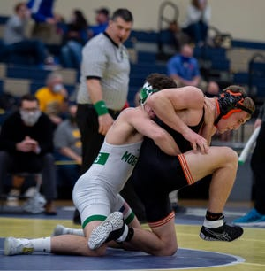 Dalton's Tate Geiser, right, tries to get out of the grasp of Mogadore's Nick Skye during a 152-pound Division III district semifinal match on Saturday. Geiser is one of many wrestlers who have technically qualified for their second consecutive state tournament, but will be wrestling for just the first time.