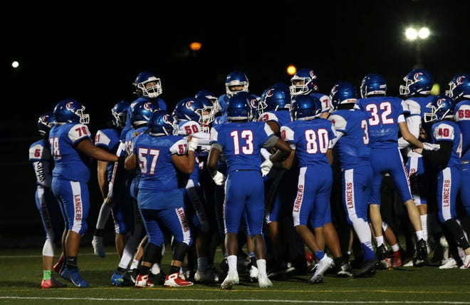 The Churchill football team gathers before the season opener last week. The excitement of being back on the field was palpable and it remains so heading into week two.