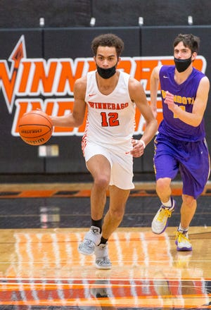Winnebago's Ray Maurchie dribbles up the court against Mendota in the first quarter of their game at Winnebago High School on Friday, March 5, 2021, in Winnebago.