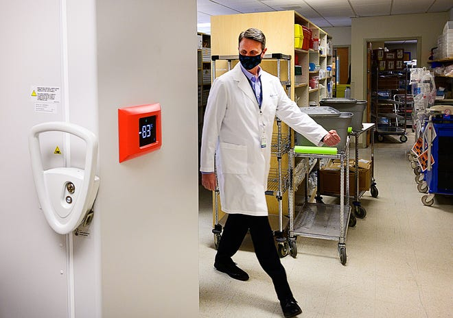 Dr. Mike Hall, the pharmacy and support services administrator for Flagler Health+, walks toward the special freezer where COVID-19 vaccines are kept at minus-82 degrees centigrade in the hospital's pharmacy on Friday.