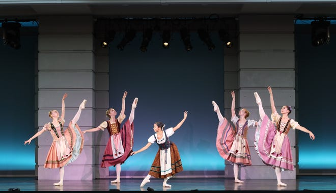 """Terri Jean Thomson, center, and cast members in an excerpt from """"Coppelia"""" performed outdoors by The Sarasota Ballet's Studio Company."""