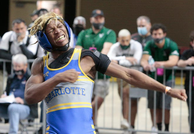 Charlotte's Isaac Church celebrates after advancing to the final of the Class 2A 132-pound weight class at the FHSAA State Championships on Saturday morning at Silver Spurs Arena in Kissimmee.