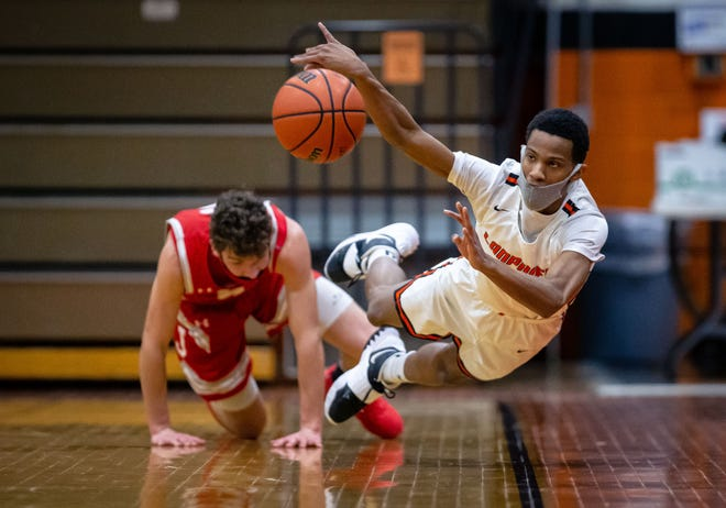 Lanphier's Tevonta Jackson saves a ball from going out of bounds after forcing a turnover from Jacksonville in the first half at Lober-Nika Gymnasium on Friday. [Justin L. Fowler/The State Journal-Register]