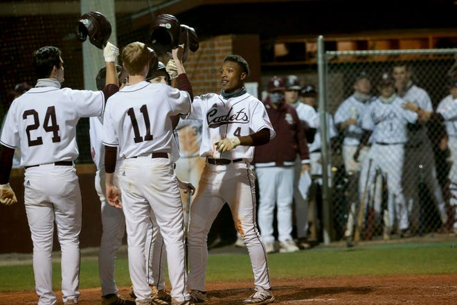 Benedictine's Justin Thomas is greeted by teammates at home plate after hitting a grand slam homer during a Friday, March 5, home game against Camden County. Thomas also hit a solo homer and walked twice as the Cadets won 10-0 in six innings as Carter Holton pitched a perfect game.