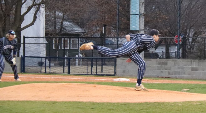 Shawnee's Bauer Brittain fires the first pitch of the 2021 season Friday against Sand Springs.