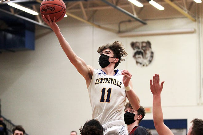 Mason Lemings of Centreville glides in for two points against White Pigeon on Friday.