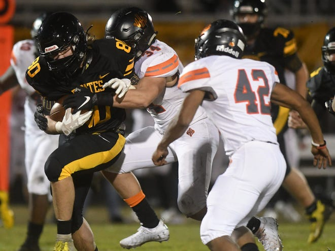 Topsail tight end Landry Horne gains yardage up the middle against New Hanover during a Mideastern Conference game in Hampstead, N.C, Friday, March 5, 2021.      [MATT BORN/STARNEWS]