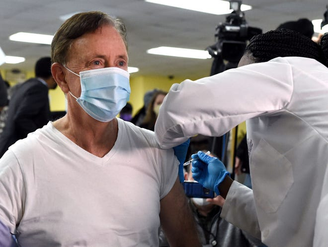 Gov. Ned Lamont receives his first dose of Pfizer's COVID-19 vaccine at The First Cathedral church in Bloomfield.\n\n\n\n\n\n