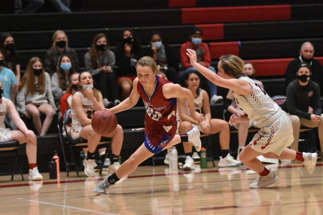Seaman's Raigan Kramer drives the ball against the defense of Emporia's Allie Baker during Friday's Class 5A sub-state championship game at Emporia. Kramer's defense was a huge key to Seaman upsetting the host Spartans 37-27.