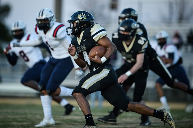 Gray's Creek senior Jerry Garcia Jr., who was wearing a sleeveless shirt with an 'S' on his chest after the game, finished with 302 rushing yards and four touchdowns against Terry Sanford.