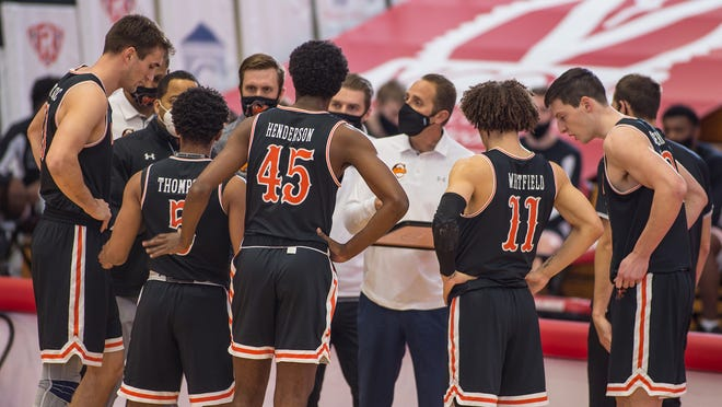 Campbell coach Kevin McGeehan, center, has led the Camels to the Big South Conference tournament title game for the first time since 2017.