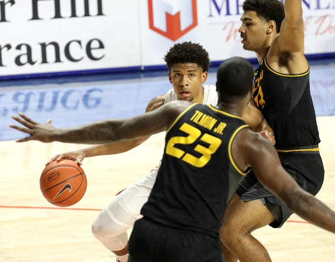 Florida guard Noah Locke looks for space to drive the ball inside against Missouri defender Jeremiah Tilmon during Wednesday's game at  Exactech Arena.