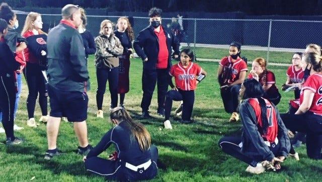 Fort White High celebrates the huge 13-1 softball win over host Buchholz on Friday.
