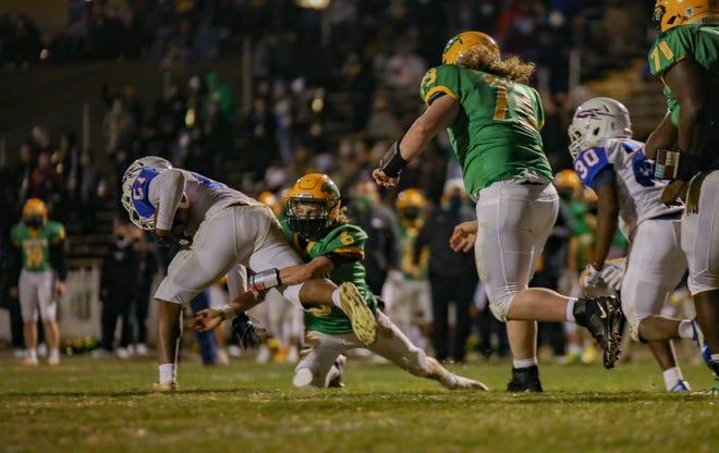 Eastern Alamance quarterback Kasen McCawley tackles Roxboro Person's Aaron Ward as Eagles lineman Brent Wheeley, right, pursues, following an interception.
