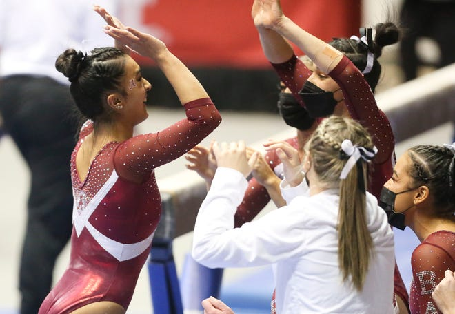 Luisa Blanco is congratulated by teammates as the Crimson Tide hosted Florida in Coleman Coliseum Stadium Friday, March 5, 2021. [Staff Photo/Gary Cosby Jr.]