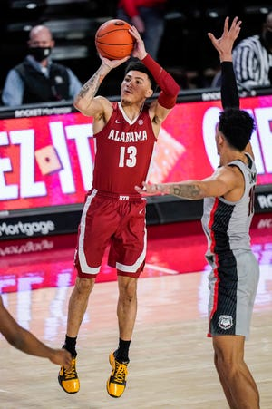 Mar 6, 2021; Athens, Georgia, USA; Alabama Crimson Tide guard Jahvon Quinerly (13) takes a shot against Georgia Bulldogs forward Toumani Camara (10) during the second half at Stegeman Coliseum. Mandatory Credit: Dale Zanine-USA TODAY Sports