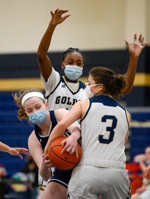 Junior Kate Joslin of Medford fights for the ball with Yasmine Alayan of Malden during a game at Malden High School on Saturday, March 6. Joslin ended up being the team's GBL all-star this year after leading them to the playoffs, where they lost to Everett in the semifinals.