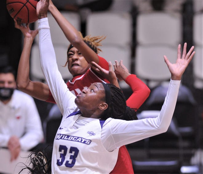 ACU's Alyssa Adams battles an Incarnate Word player for a rebound. ACU beat the Cardinals 64-55 in the Southland Conference game March 6 at the Teague Center.