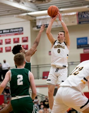 Centerville point guard Gabe Cupps, here shooting in a game against Mason, has taken official recruiting visits to Ohio State, Indiana and Michigan.