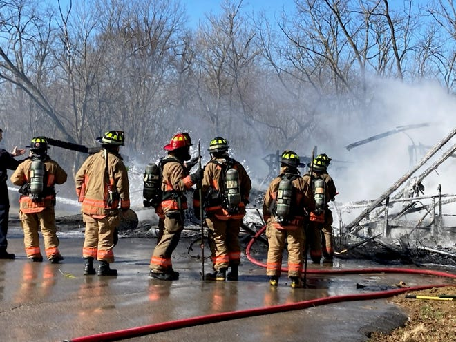 A fire in a garage and attached structure in Colerain Township this morning sent clouds of heavy smoke billowing 150 feet into the air.