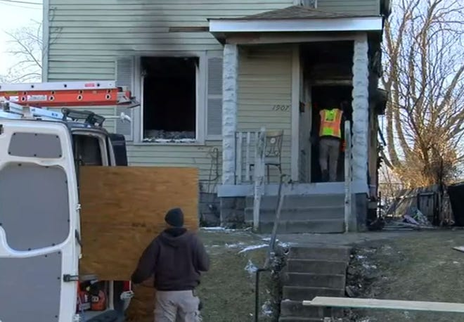 Workers were boarding up a house in Norwood Saturday following a fire that killed one person and sent two others to the hospital March 6.