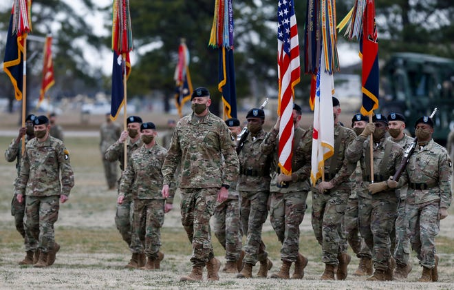 Soldiers march up the field towards the Passing of the Colors ceremony at the 101st Airborne Division (Air Assault) and Fort Campbell Division Change of Command at Parade Field in Fort Campbell, KY., on Friday, March 5, 2021.