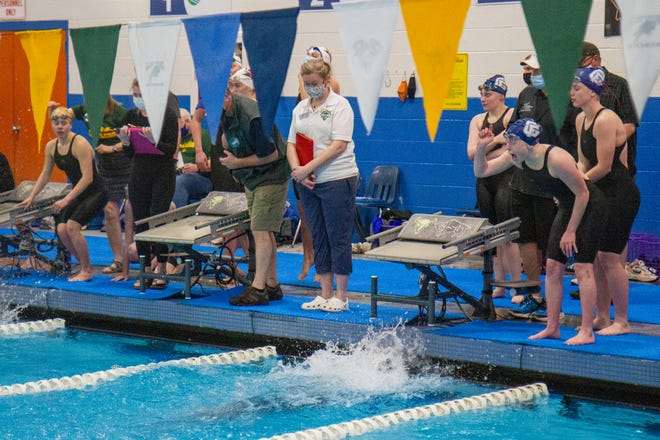 Members of the Bison girls 400 freestyle relay cheer on their teammate at the AA State Swim Meet on Friday, Mar. 5 that was hosted in Great Falls. The Bison girls placed second in the event with a time of 3:47.93.