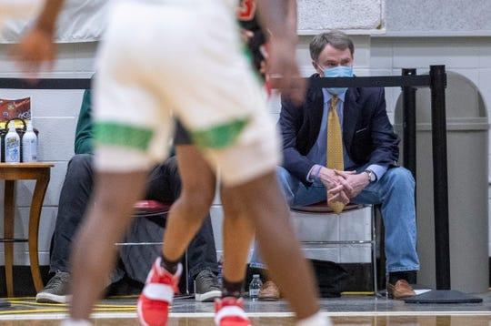 Indianapolis Mayor Joe Hogsett takes in the early game on Friday, March 5, 2021, during sectional play at Indianapolis' Arsenal Tech High School. North Central beat Indianapolis Crispus Attucks High School 72-59.