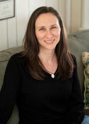 Linda Hogoboom poses for a photo in her Boonton home on Friday March 5, 2021. Hogoboom urged her local leaders in Boonton to implement gender-inclusive language. Specifically, she wanted the town's Board of Aldermen to become the Town Council. After eight months she was able to achieve her goal.