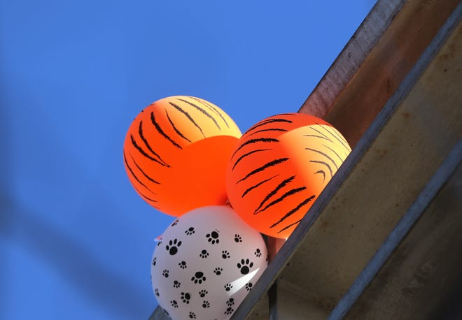 Balloons are displayed on the bridge over the Animas River on West Aztec Boulevard prior to the start of Aztec High School's first home football game.