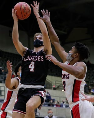 Lourdes Academy's Preston Ruedinger (4) puts up a shot against The Prairie School during the WIAA Division 4 state championship game at the La Crosse Center. Ruedinger was voted first-team all-state Monday.