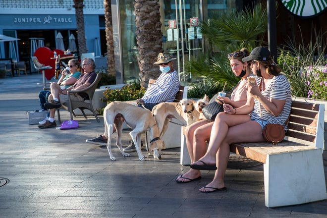 People enjoy the sunshine in downtown Palm Springs, Calif., on February 19, 2021.