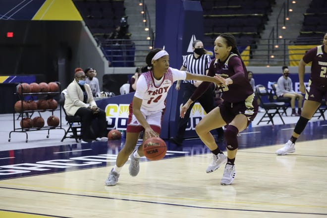Tiyah Johnson of Troy tries to dribble past Tianna Eaton of Texas State in a Sun Belt Conference tournament game at the Pensacola Bay Center in Florida. Troy prevailed in overtime as both the Texas State women's and men's teams were knocked out of the tournament Saturday.