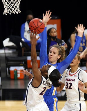 Arizona guard Aari McDonald (2) shoots as UCLA forward Emily Bessoir defends during the first half of an NCAA college basketball game in the semifinals of the Pac-12 women's tournament Friday, March 5, 2021, in Las Vegas. (AP Photo/Isaac Brekken)