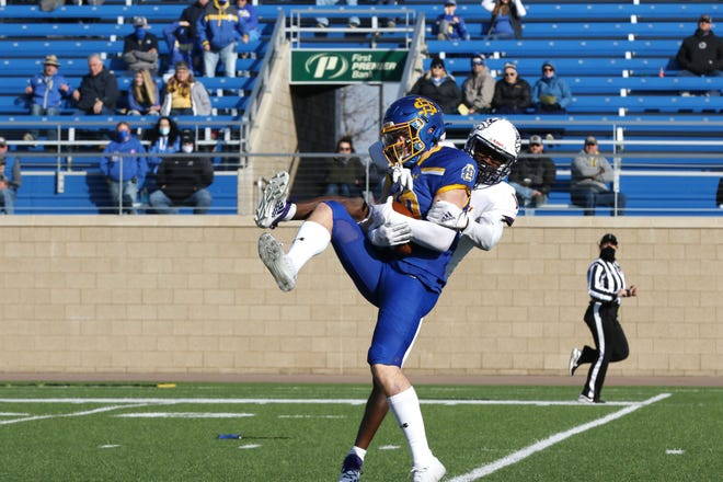 South Dakota State wide receiver Jaxon Janke comes down with the ball against Western Illinois in the Jacks' home opener on Saturday, March 6, 2021, in Brookings.