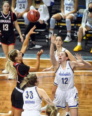 Omaha's Sophie Johnston makes a basket as  South Dakota State's Kallie Theisen reaches too late to block it in the first round of the Summit League Tournament on Saturday, March 6, 2021, at the Sanford Pentagon in Sioux Falls.