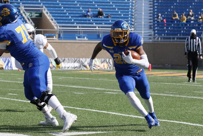 South Dakota State running back Pierre Strong runs against Western Illinois in the Jacks' home opener on March 6, 2021, in Brookings.