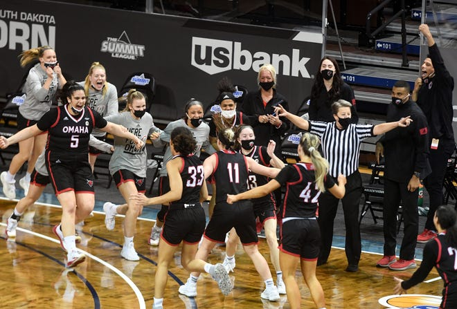 Omaha women rush onto the court to celebrate their upset of South Dakota State in the first round of the Summit League Tournament on Saturday, March 6, 2021, at the Sanford Pentagon in Sioux Falls.