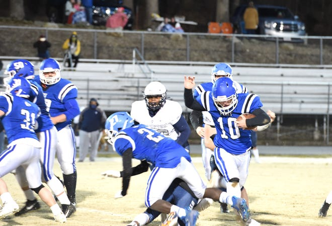Fort Defiance's Riley Miller tries to keep his feet while running against Staunton Friday, March 5. Fort won 38-10.