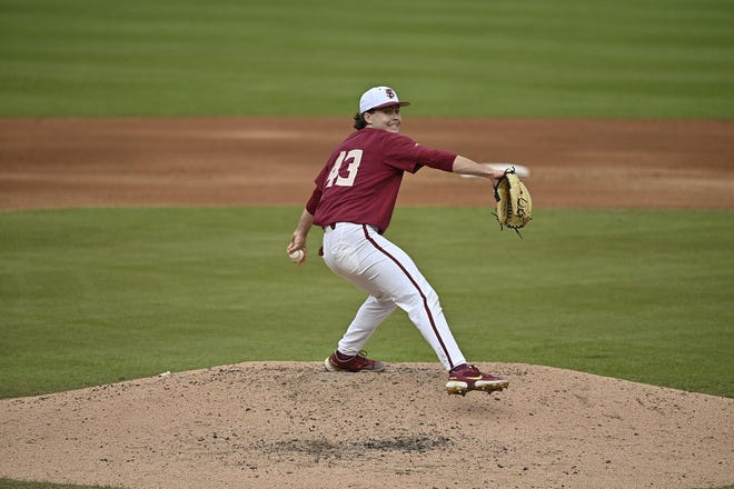 FSU pitcher Bryce Hubbart goes through his windup during the Seminoles' game against Virginia on March 6, 2021.