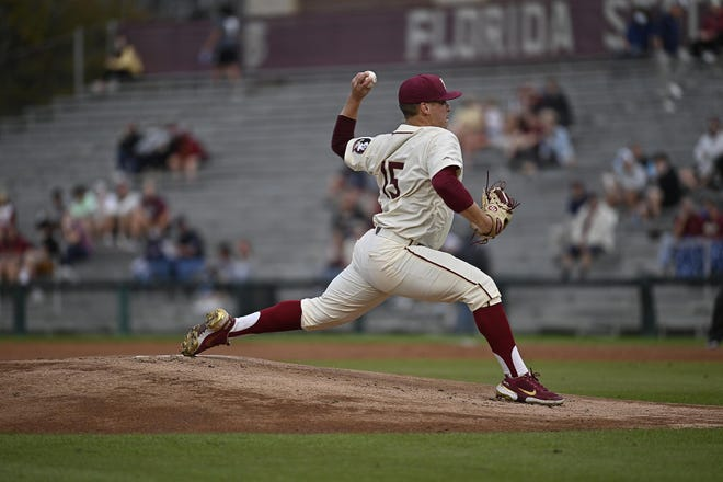 FSU pitcher Parker Messick readies the pitch during the Seminoles' game against Virginia on March 5, 2021.