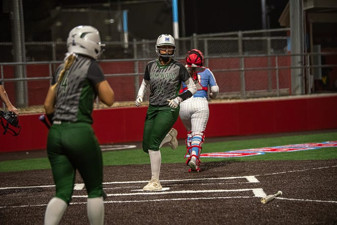 Montwood's Lauren Garcia runs home. Montwood defeated Socorro High School 5-0 in varsity girls softball at Socorro High School on Mar. 5, 2021.
