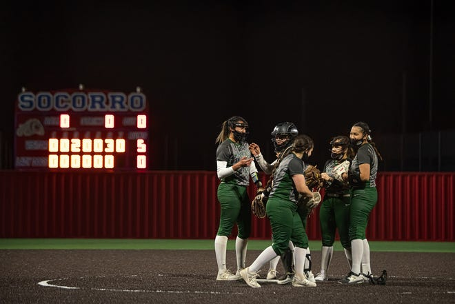 Montwood players have a last meeting on the pitchers mound. Montwood defeated Socorro High School 5-0 in varsity girls softball at Socorro High School on Mar. 5, 2021.