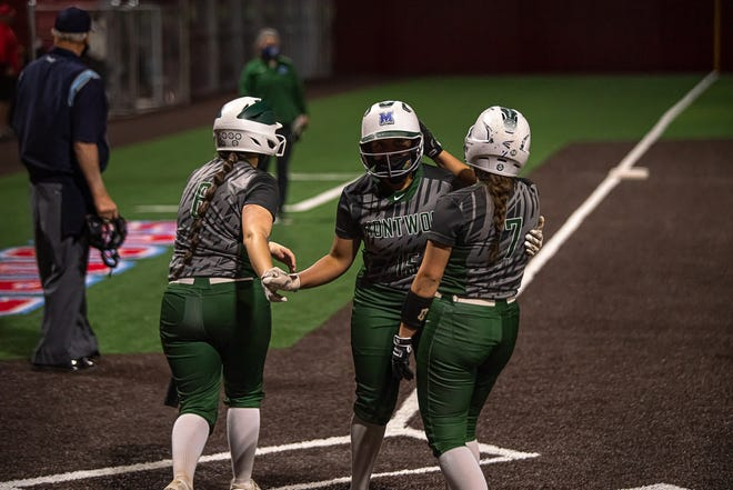 Montwood's Angelina Levy, center, celebrates a home run with teammates. Montwood defeated Socorro High School 5-0 in varsity girls softball at Socorro High School on Mar. 5, 2021.