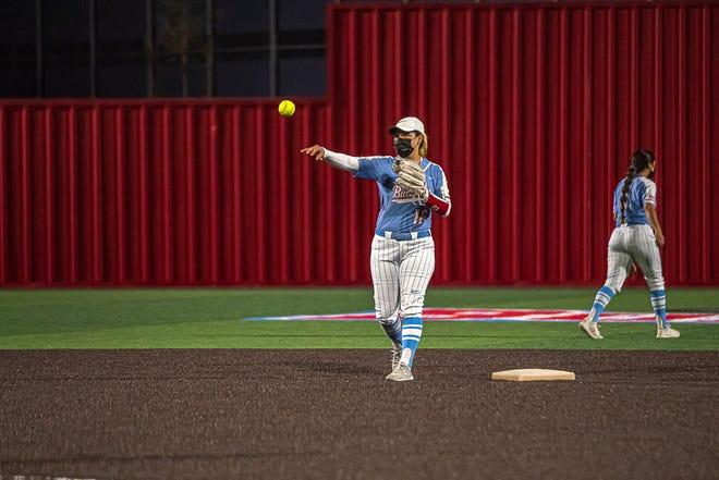 Socorro's Melanie Melendez throws the ball to teammate. Montwood defeated Socorro High School 5-0 in varsity girls softball at Socorro High School on Mar. 5, 2021.