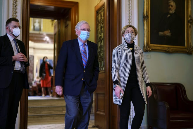 Senate Minority Leader Mitch McConnell, R-Ky., leaves the chamber just after voting against the Democrat's $1.9 trillion COVID-19 relief bill, at the Capitol in Washington, Saturday, March 6, 2021.